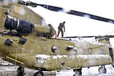 Snow removal duty. A U.S. soldier sweeps snow from a CH-47 Chinook helicopter on Bagram Airfield, Afghanistan, Feb. 6, 2013. The soldiers are assigned to the 101st Airborne Division's 159th Combat...