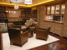 Stocked wine cellar and bar room.