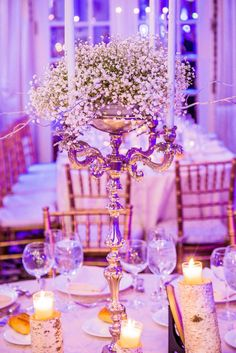 Baby's breath candelabra center pieces with silver branches. Birch tree candle holders. Winter wedding. Crystal Plaza, Livingston, NJ. Flowers by House of Flowers, Linden, NJ. Photo by Andrew Todes www.todesphoto.com