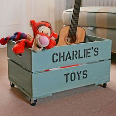 """A """"Harry's"""" crate toy box, in shabby blue."""