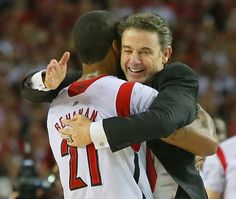 Louisville forward Chane Behanan embraces head coach Rick Pitino who gives him a pat on the back after defeating Michigan to win the NCAA Division I National Championship on Monday, April 8, 2013, in Atlanta. Louisville beat Michigan 82-76 for NCAA title. (AP Photo/Atlanta Journal Constitution, Curtis Compton