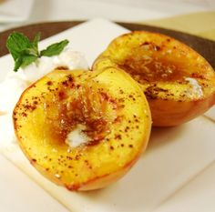 1.  Halve peaches and remove pit.  Place in baking dish, skin side down.     2.  Place 1/2 teaspoon butter in the hollow of each peach, top each peach half with 1 or 2 teaspoons brown sugar, and sprinkle with cinnamon.     3.  Bake at 375 degrees until peaches are tender, about 30 minutes.  Serve warm.