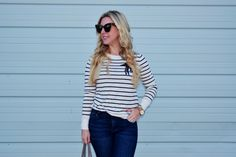 I like the versatility of a classic navy blue and white stripe sweater. I fell in love with this adorable stripe sweater with peacock detail the minute I spotted it while shopping at the LOFT. I saw it front and center on the front table as I entered the store and it was a no…