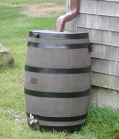 Plastic rain barrel made to look like wood barrel