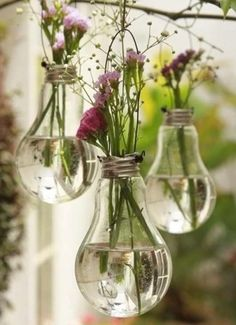 Very cool idea: use old light bulbs for a festive vase to hang in the garden.