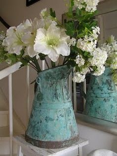 Love putting flowers in old containers instead of a traditional vase.