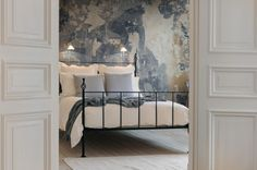 Concrete, bricks and wooden boards, but also weathered and elegant wallpaper in subdued colors that suit a home with a lot of personality. http://rebelwalls.com/wallpaper/surfaces/