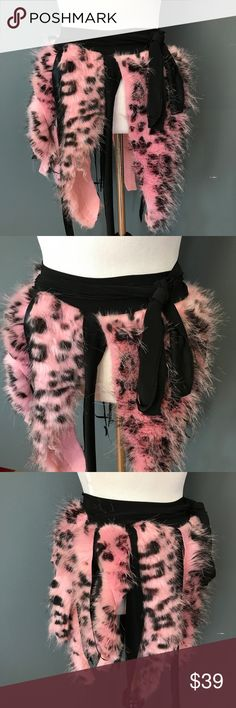 "Pink Leopard Fur Halloween Mini Skirt - One Size Womens Sexy Leopard Halloween Costume Mini Skirt Pink Black Fur Fringe Raver Edm  HANDMADE & READY TO SHIP!  Great for Halloween and Edm costumes! Dance the day or night away in this reclaimed wrap skirt! Wear it over leggings, boy shorts, bikinis.  Light pink leopard faux fur with black metallic nylon fringe.  Size: One Size Fringe Length: 12""-24""  Waistband Length: 65"" (You can wrap it around your waist twice depending on your waist size!)…"