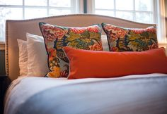 Contrasting welting on this trio of pillows helps to crisp up the edges and underscore the palette.