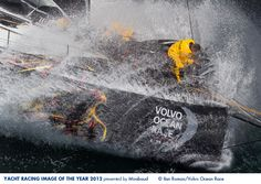 Photo by Ian Roman - 1st July 2012, France, Lorient during the Volvo Ocean Race, Leg 9 Lorient-Galway. Wade Morgan (right), Justin Slattery (centre) and Adil Khalid (top left) on the bow of Abu Dhabi Ocean Racing.  Yacht Racing Image of the Year 2012.