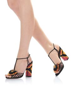Samba Sandal 105All eyes will be on you in our striking Samba sandal. Made in Italy from our velvety rich black suede, this t-strap style with raffia fringe sits upon an on-trend block heel with an exotic pattern. Self-adjustable ankle strap completes the look. Keep the pair in focus with ankle-length denim or a classic little black dress.$ 925$ 555
