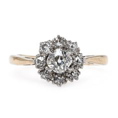 Venice is an incredible antique Victorian engagement ring featuring a cluster of Old Mine Cut diamonds! // $4,100