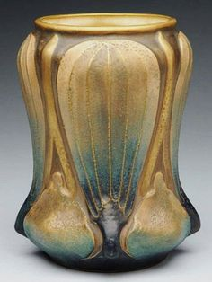 AMPHORA POTTERY Art Nouveau vase, stylized blossoms hug the form