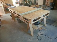 Paulk workbench boxes on sawhorses. If one box had a recessed position, then it could also be a miter saw bench.