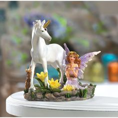 Fairy And Unicorn Statue Home Decor - A fair-haired fairy pauses by a clear forest pool, her unicorn companion sharing the morning's magic beauty. The serene scene of this Fairy And Unicorn Statue Home Decor is sure to bring a little magic into the life of every admirer!