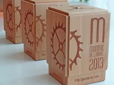 "Engraved wooden trophies for ""watch of the year"" designed and manufactured by Dietlin for magazine Montres-Passion (L'Hebdo)."