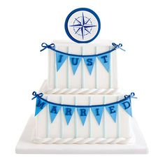 WEDDING STYLE: PREPPY NAUTICAL  A gum-paste compass tops a cake with pennant and rope details.    $11 per slice (serves 40), Eat Cake Be Merry.