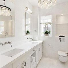 White Bathroom with Sparkly Chandelier