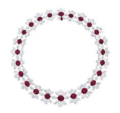 A RARE RUBY AND DIAMOND NECKLACE, BY J.W. CURRENS   Designed as a series of twenty-four graduated oval-shaped rubies weighing from 6.06 to 1.27 carats, within a marquise and pear-shaped diamond surround, the clasp accented by a pear-shaped ruby weighing 0.50 carat, mounted in 18k white gold, 44.0 cm long  Signed and with maker's mark for J.W. Currens