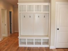I want to convert our coat closet in the entry way into a smaller version (1/2 the width) of this white built-in for coats and shoes....Maybe with little baskets in it for storage kellimarek