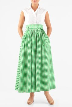A removable slim sash tie belt beautifully cinches in the high  banded waist of our feminine cotton gingham check maxi dress styled with ruched pleats for a full flare.