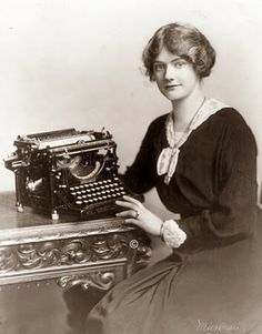 This picture was taken in 1918, and it shows a woman next to a state of the art Underwood typewriter.