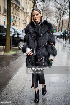 Olivia Palermo is seen in the streets of Paris after the Giambattista Valli show during Paris Fashion Week Womenswear Fall/Winter 2017/2018 on March...