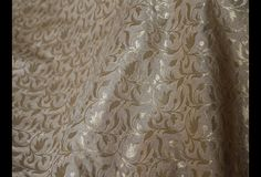 This is a beautiful pure benarse silk brocade floral design fabric in Beige and Gold. The fabric illustrate small golden woven floral vines on Beige background.  You can use this fabric to make...