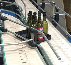 lane changing slat conveyor for handling trays of small bottles for more information contact C-Trak on 01525 850316