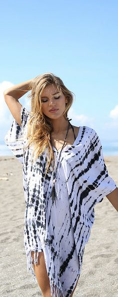 bacae181893b Rippling tie dye patterns echo the rhythm of ocean waves on the beach, the  perfect place to wear this relaxed caftan swim cover up.