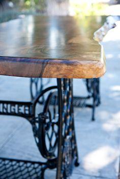 Walnut Slab Table with Sewing Machine base.  Beautiful.