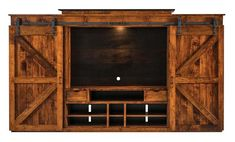 Sliding Door Teton Entertainment Center This grand display is full of rustic warmth. Relax in a living room with the Teton and its cozy barn door style. There's plenty of room to house your TV and store all your media to select from easily.