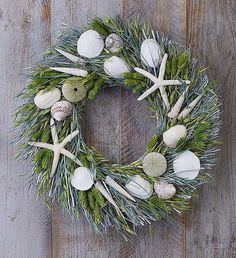 Create a coastal-chic look at home with our Preserved Seaside Wreath. Beautifully handcrafted, this preserved, seaside inspired wreath features a display of seashells and a pair of white starfish, bringing easy-breezy style into any summer home décor. Summer Flowers To Plant, Summer Plants, 800 Flowers, Flower Pot Design, Sympathy Flowers, Funeral Flowers, Flowers Online, Summer Wreath, Flower Delivery