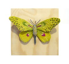 This little yellow butterfly is about 3 1/2 inch tall, 6 inch wide and made from cotton fabric. Their wings and body are hand painted and hand embroidered with details. Mounted on 6 x 6 natural finished wooden box with metal hook on the back for hanging.