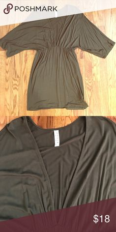 Olive color boutique dress/tunic V-neck and 3/4 length sleeve dress or tunic. Not lined. The v-neck is cut very low. Dress falls above the knee jolie Dresses Mini
