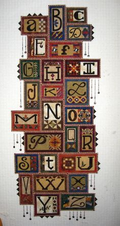I love this alphabet quilt!!!  The details are stunning.  By Janet Stone.