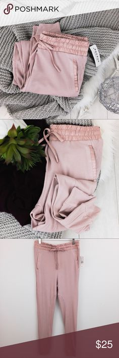 """Me to We • Sleep or Lounge Pants Me to We • These comfortable lounge or sleep pants feature a drawstring satin waistband and satin trimmed side pockets. Extra detailing includes a faux fly and inner leg gussets. A great neutral blush color (tag reads adobe rose). Perfect with a sweatshirt or tee. Waffle weave knit made of 97% rayon-3% spandex and 100% polyester satin trim. // measurements taken laying flat and relaxed - waist 28"""" / rise 11"""" / inseam 25"""" from crotch to bottom of cuff // New…"""