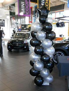 Black and silver balloon columns