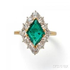 Emerald and Diamond Ring, prong-set with a #kite-shape #emerald measuring approx. 13.00 x 9.00 x 3.50 mm, framed by old #European-cut #diamonds #platinum and 18kt gold mount, size 8 1/4. Estimate $2,500-3,500