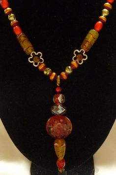 Autumn Glow Long Necklace : Warm Yellow and Red Glass Beads and Lampwork Avant Garde Statement Necklace Fall Colours. $80.00, via Etsy.