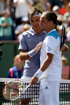 Roger Federer Alexandr Dolgopolov Photos - Roger Federer of Switzerland is congratulated by Alexandr Dolgopolov of Ukraine after their match during the semifinals of the BNP Parabas Open at the Indian Wells Tennis Garden on March 15, 2014 in Indian Wells, California. - BNP Paribas Open - Day 13