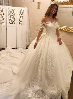 Chic off shoulder wedding dresses with train appliqués, fashion wedding gowns with long sleeves.