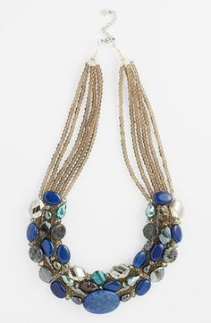"""Lavish strands of smoky quartz suspend an abundance of semiprecious stones on a handcrafted statement necklace. 20 1/2"""" length; 1 1/2"""" drop. Lobster clasp closure. Czech crystal/smoky quartz/glass/agate/freshwater pearl/shell/metal."""