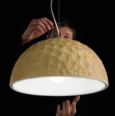 Wonderful Tick pendant light by Andrea Costa for Ilide. A solid piece of wood that is hollowed out and then a pattern is roughly chiseled into it, so that it is very obviously WOOD!