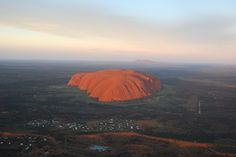 Ayers Rock at sunrise from a helicopter.
