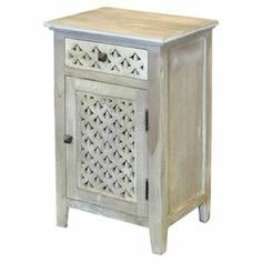 """Weathered mango wood cabinet with 1 drawer and 1 door.  Product: CabinetConstruction Material: MangoColor: Weathered greyFeatures: One drawerOne doorOpenwork detailsDimensions: 28.5"""" H x 17.5"""" W x 13.5"""" D"""