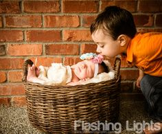 Perfect newborn photo for a baby with an older toddler sibling.  Brotherly love captured perfectly!
