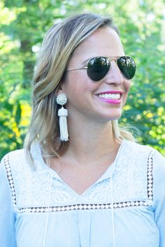 Lisi Lerch Tassels Earrings and Ray-Ban sunglasses