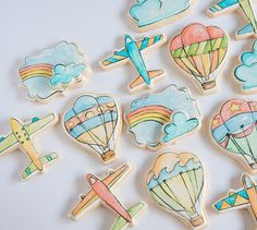 airplane and hot air balloon watercolor painted cookies