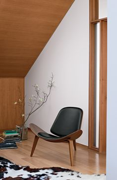 "Sometimes we call this the ""Smile Chair."" Shell Chair 